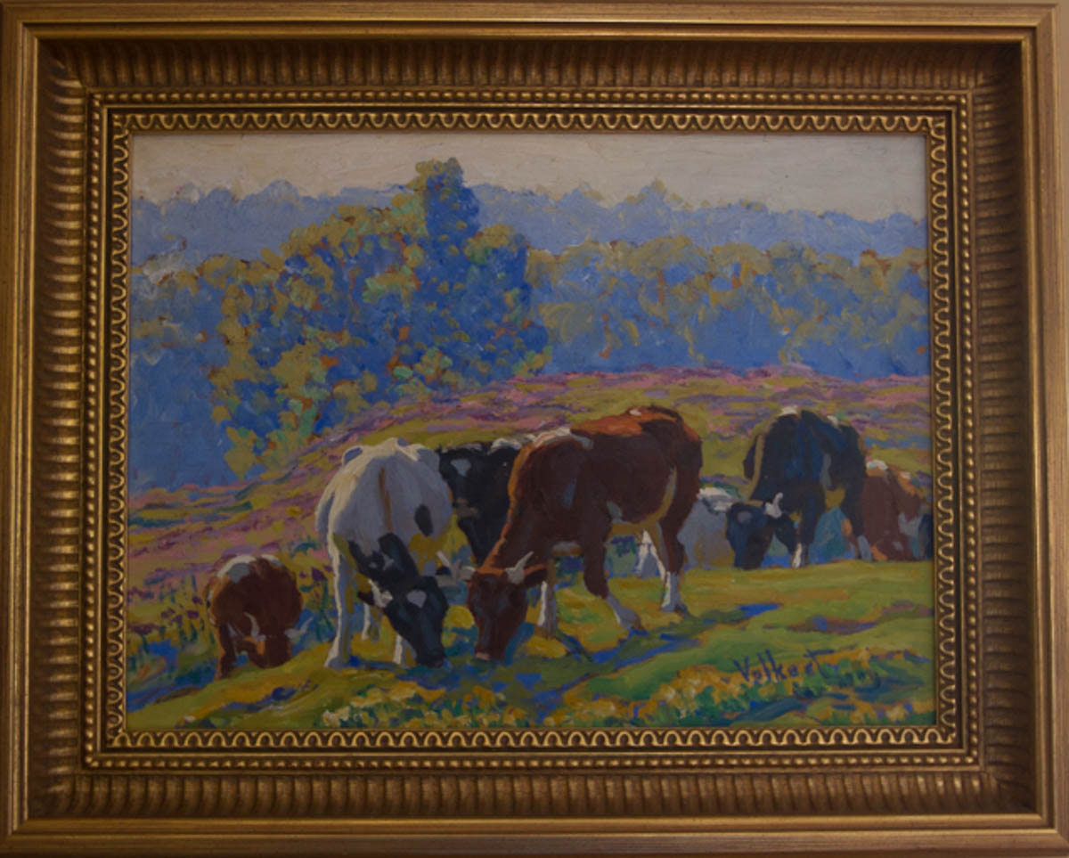 Untitled [White and brown cows grazing with heads together]